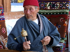 Prayer beads and wheel; a very pious Buddhist