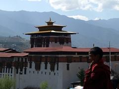 Monk standing in front of Paro Dzong