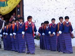 Ladies dressed in formal kiras dancing at the Paro Festival