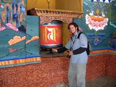 Robby spinning a prayer wheel; Paro Dzong
