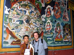 Aryan and Robby pose next to a massive Mandala; Paro Dzong