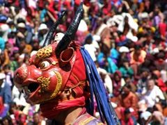 This mask must be heavy and uncomfortable! The monk wore it for hours while dancing in the blazing sun; Paro Tsechu