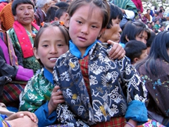 Two cuties! Young girls dressed in their finest kiras; Day 5 of Paro Tsechu (Dawn ceremony)