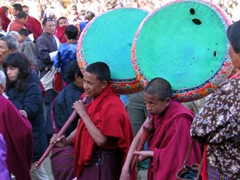 Young monks struggle to carry their heavy drums; Paro Tsechu