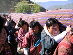 Carrying the ancient Thangka back to the Paro Dzong until next year's ceremony