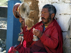 Drums and bells; this pilgrim earned a ton of donations during the Paro Tsechu