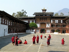 Monks tasked with cleaning the Wangdue Dzong courtyard