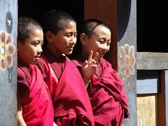 Young monks flashing a peace sign; Wangdue Dzong