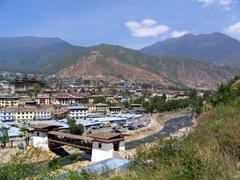 View of Paro and the traditional wooden covered bridge (Nyamai Zam) across the Paro Chhu (Paro River) from Paro Dzong