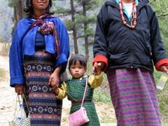 Bhutanese family walking down from the Begana Choten