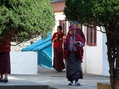 Locals spinning prayer wheels while circumambulating the National Memorial Chorten (Druk Wang Gyal Chorten)