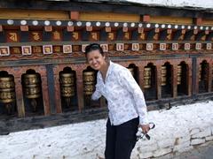 Becky turning prayer wheels at Changangkha Lhakhang monastery; Thimphu