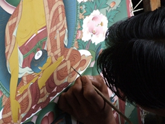 Student of Choki Traditional Art School painting a Thangka