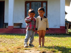 Cute Tharu boys posing for a photo (one with pants and the other opted to pose without)