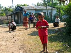 A curious Tharu family checks us out; near Chitwan National Park
