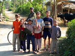 Photo of Tharu boys living near Chitwan National Park (the Tharu are an ethnic group indigenous to the Terai region, which is the southern foothills of the Himilayas in both Nepal and India)