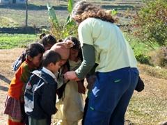 Becky showing children their photo, Pokhara