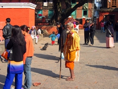 A sadhu wanders barefoot in Patan