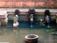 A local wading through a pool to collect water, Patan Durbar Square