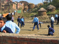 Bhaktapur schoolboys playing around in a field