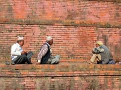 Men relaxing at Bhaktapur Durbar Square