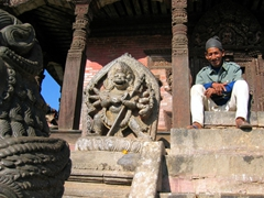 A friendly Nepalese man grins at us; Nyatapola Temple in Bhaktapur