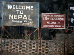 """""""Welcome to Nepal"""" sign at the Sunauli border crossing from India to Nepal"""