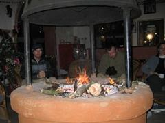 Robby huddles next to the fire at the Safari Narayani Lodge; Chitwan National Park