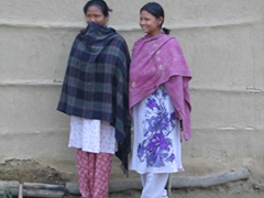 These two Tharu women smile as they watch the village children interact with us