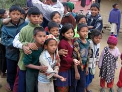 The children of this Tharu village are well behaved, queuing up for a distribution of school supplies
