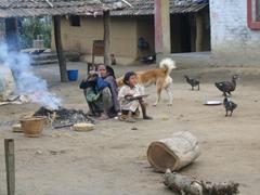 Tharu village scene, breakfast by a smouldering fire