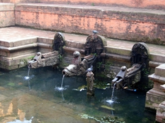 A pool of water (which locals use for drinking, cooking or laundry); Patan Durbar Square