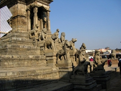 5 pairs of matching figures on the terraces of this temple in Bhaktapur