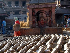 Another view of Bhaktapur's famous pottery square (the kiln in the middle is fueled by the nearby hay)