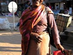 A happy silk purse vendor; Bhaktapur
