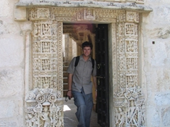 Robby standing inside one of Ranakpur's intricately carved Jain temple entrances