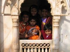 Cute kids pose in a Karni Mata Temple window