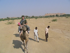 Robby enjoying his camel ride (Jaisalmer in the background)