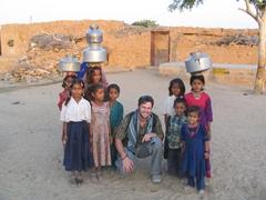 Robby surrounded by village kids; Jaisalmer desert