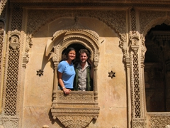 Becky & Robby peering through a typical Rajasthani window; Patwon-Ki-Haveli
