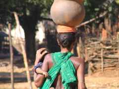 Precarious balance trick! Soura tribal woman carries her child and two clay pots