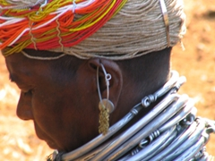 Close up of a Bonda woman's beaded head-dress and necklaces