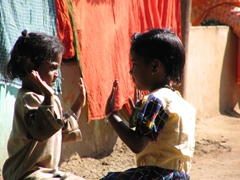Children playing patty-cake at the Bonda Tribal market