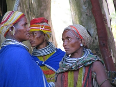 Beautifully ornate Bonda Tribal women gossiping at the weekly market