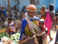 Bonda tribal woman shopping with baby in tow