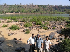 Saroj, Robby, and Brasanda posing in the foreground of the Chitrakote waterfall, Chhattisgarh