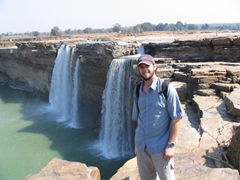Robby poses next to the Chitrakote Waterfall