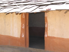 Typical entrance to a Maria Tribal dwelling; notice the hand-prints on both sides of the doorway