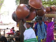 Maria tribal woman carrying clay pots for sale, Mardoom market