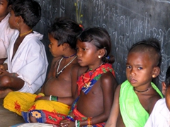 3 independent Dhuruba tribal children refuse to don the official school uniform; opting for their tribal outfit instead